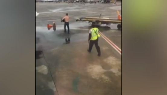 Erratic Shirtless Passenger Attempts Fight With Airport Ground Crew On Tarmac