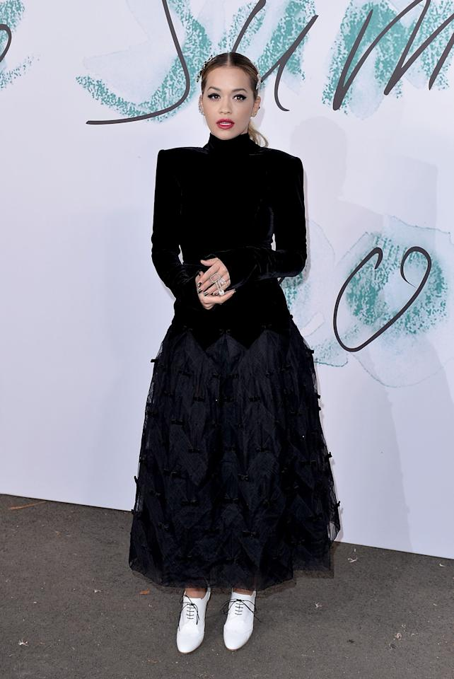 <p>Rita sported a high-necked velvet Chanel gown with heeled white shoes.<br /><i>[Photo: Getty]</i> </p>