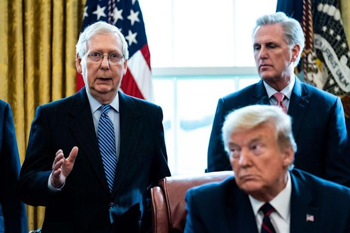 Republican congressional leaders Mitch McConnell, left, and Kevin McCarthy, right, have taken a stance of appeasing Donald Trump's tenacity on disputing the election results. (Getty Images)