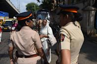Policewomen stand on a street in Mumbai on November 9, 2019, as security was tightened across India for a Supreme Court ruling over a holy site contested for centuries by Hindus and Muslims. - Police were put on alert nationwide ahead of the ruling, with thousands of extra security personnel deployed and schools closed in and around the northern city of Ayodhya, centre of the spat. (Photo by INDRANIL MUKHERJEE / AFP) (Photo by INDRANIL MUKHERJEE/AFP via Getty Images)