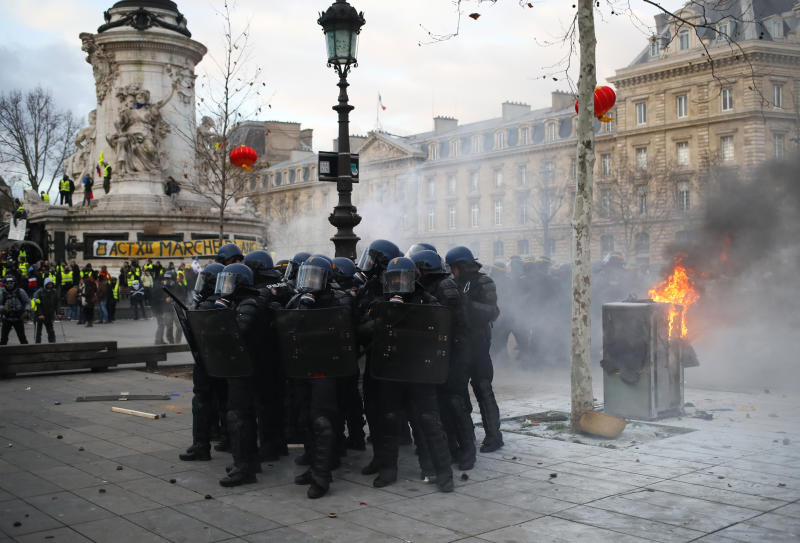 FILE - In this Saturday, Feb. 2, 2019 file photo riot police officers take position on the Place de la Republique during a yellow vest protest in Paris. (AP Photo/Francois Mori, File)