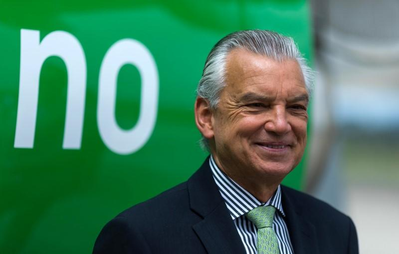 The CEO of Brazilian planemaker Embraer SA, Souza e Silva, smiles during a ceremony as Embraer delivers first E2-190 jet to Norway's Wideroe at the company's headquarters in Sao Jose dos Campos