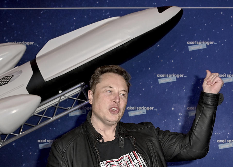 SpaceX owner and Tesla CEO, Elon Musk arrives on the red carpet for the Axel Springer media award, in Berlin, Germany, Tuesday, Dec. 1, 2020. (Britta Pedersen/Pool via AP)