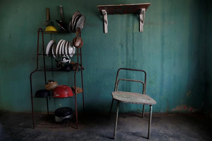 A chair stands next to kitchen equipment in the house of Aidalis Guanipa, 25, a kidney disease patient, during a blackout in La Concepcion, Venezuela. (Photo: Ueslei Marcelino/Reuters)