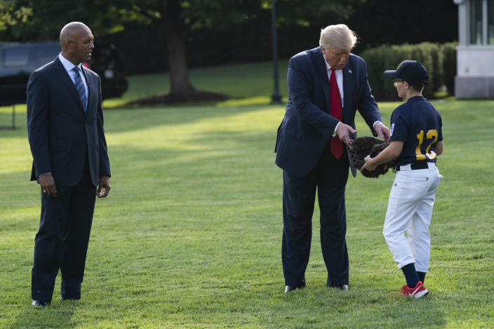 Former New York Yankees Hall of Fame pitcher Mariano Rivera and President Trump greet youth baseball players on the South Lawn of the White House on Thursday. (Evan Vucci/AP)