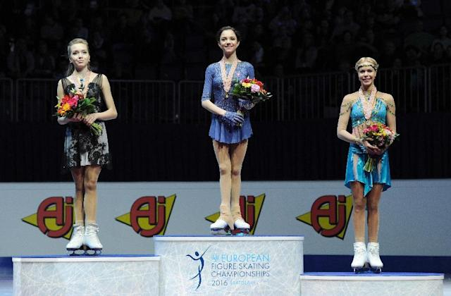 Russia's first placed Evgenia Medvedeva (C) on the podium with second placed Elena Radionova (L) and third placed Anna Pogorilaya, during the European Figure Skating Championships in Bratislava on January 29, 2016 (AFP Photo/Samuel Kubani)