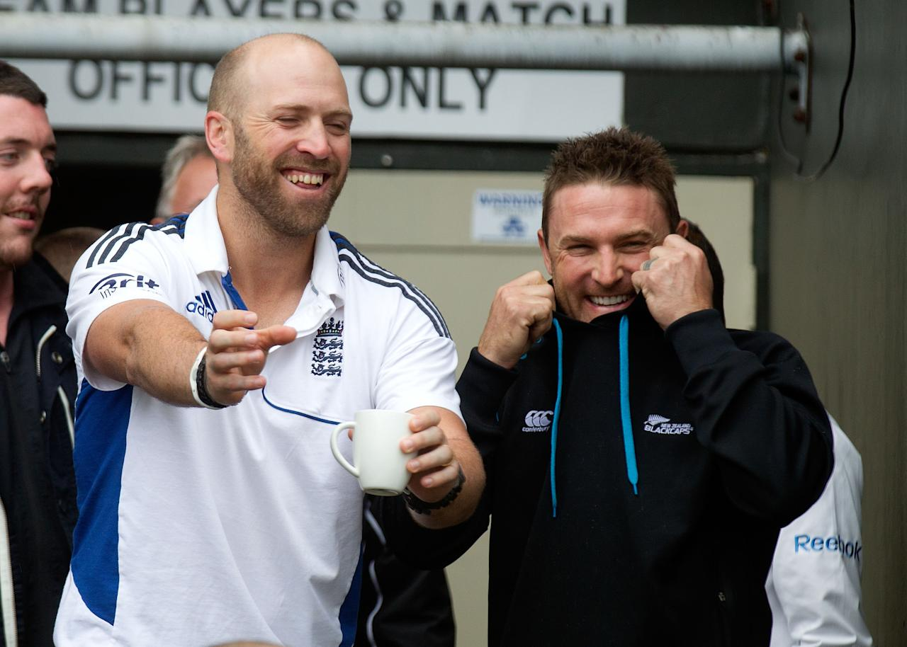 England's Matt Prior (L) jokes with New Zealand captain Brendon McCullum as rain halts play during day five of the international cricket Test match between New Zealand and England played at the Basin Reserve in Wellington on March 18, 2013.   AFP PHOTO / Marty MELVILLE        (Photo credit should read Marty Melville/AFP/Getty Images)