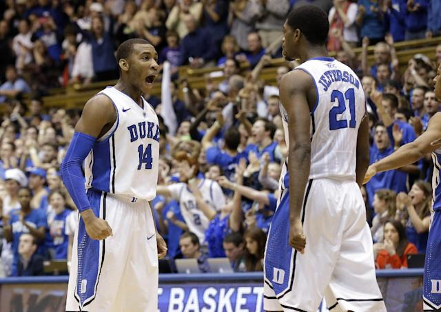 Duke's Rasheed Sulaimon (14) and Amile Jefferson (21) react late in the second half of an NCAA college basketball game against Virginia in Durham, N.C., Monday, Jan. 13, 2014. Duke won 69-65. (AP Photo/Gerry Broome)