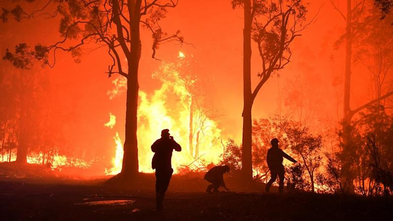 """The Currowan blaze, on the NSW South Coast, has been downgraded to a """"watch and act"""" alert level"""