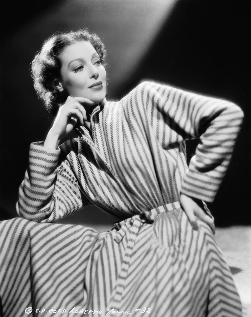 Young wears a striped robe in this image from 1940.