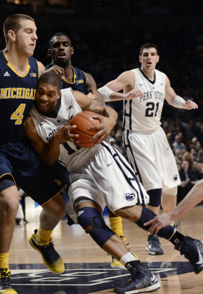 Penn State's Jermaine Marshall (11) drives on Michigan's Mitch McGary (4) during the first half of an NCAA college basketball game in State College, Pa., Wednesday, Feb. 27, 2013. (AP Photo/Ralph Wilson)