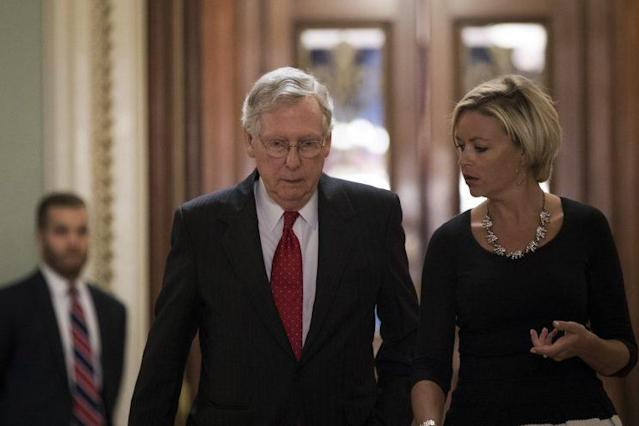 Senate Majority Leader Mitch McConnell walks with an aide as he leaves the Senate floor Thursday. (Photo: Drew Angerer/Getty Images)