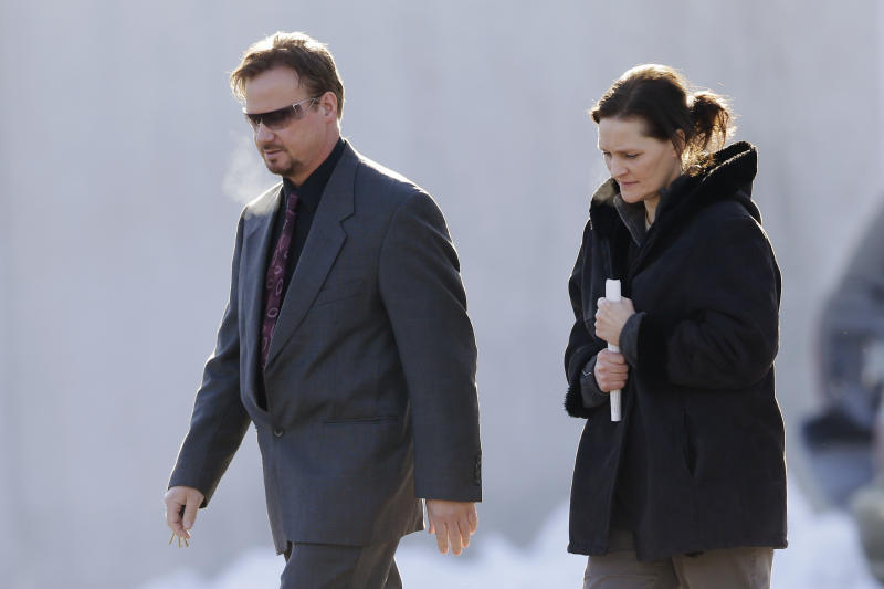 Accompanied by his wife Brigitte, right, former United Methodist pastor Frank Schaefer, of Lebanon, Pa., departs after a meeting with officials at the Eastern Pennsylvania Conference of the United Methodist Church, Thursday, Dec. 19, 2013, in Norristown, Pa. Church officials have defrocked Schaefer, who officiated his son's gay wedding in Massachusetts. (AP Photo/Matt Rourke)