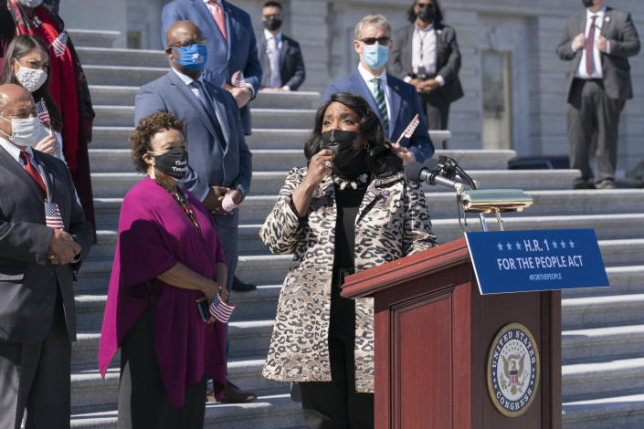 Rep. Terri Sewell, D-Ala., recalls the work of the late Rep. John Lewis as Democrats gather to address reporters on H.R. 1, the For the People Act of 2021, at the Capitol in Washington, Wednesday, March 3, 2021. House Democrats are poised to pass a sweeping elections and ethics bill, offering it up as a powerful counterweight to voting rights restrictions advancing in Republican-controlled statehouses. (AP Photo/J. Scott Applewhite)
