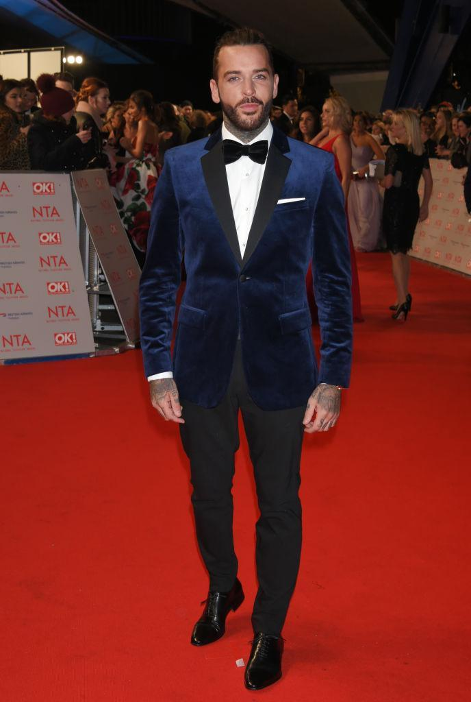 <p>Steering clear of the go-to monochrome tux, Pete Wicks opted for a velvet number. <em>[Photo: Getty]</em> </p>