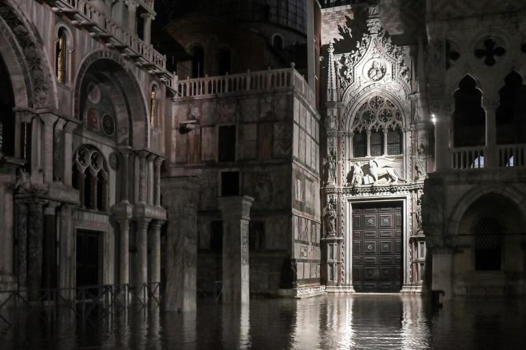 St. Mark's Basilica and a part of the Doge's Palace (R) are pictured on the flooded St. Marks' Square on November 12