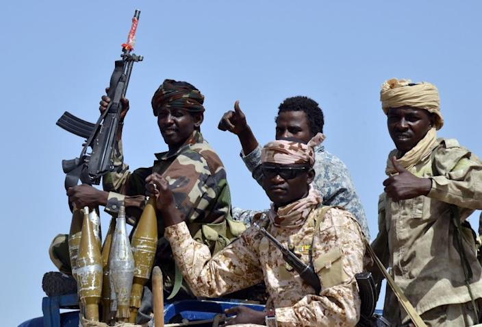 Chadian army soldiers sit in a military vehicle in Malam Fatori, northern Nigeria, on May 25, 2015 (AFP Photo/Issouf Sanogo)