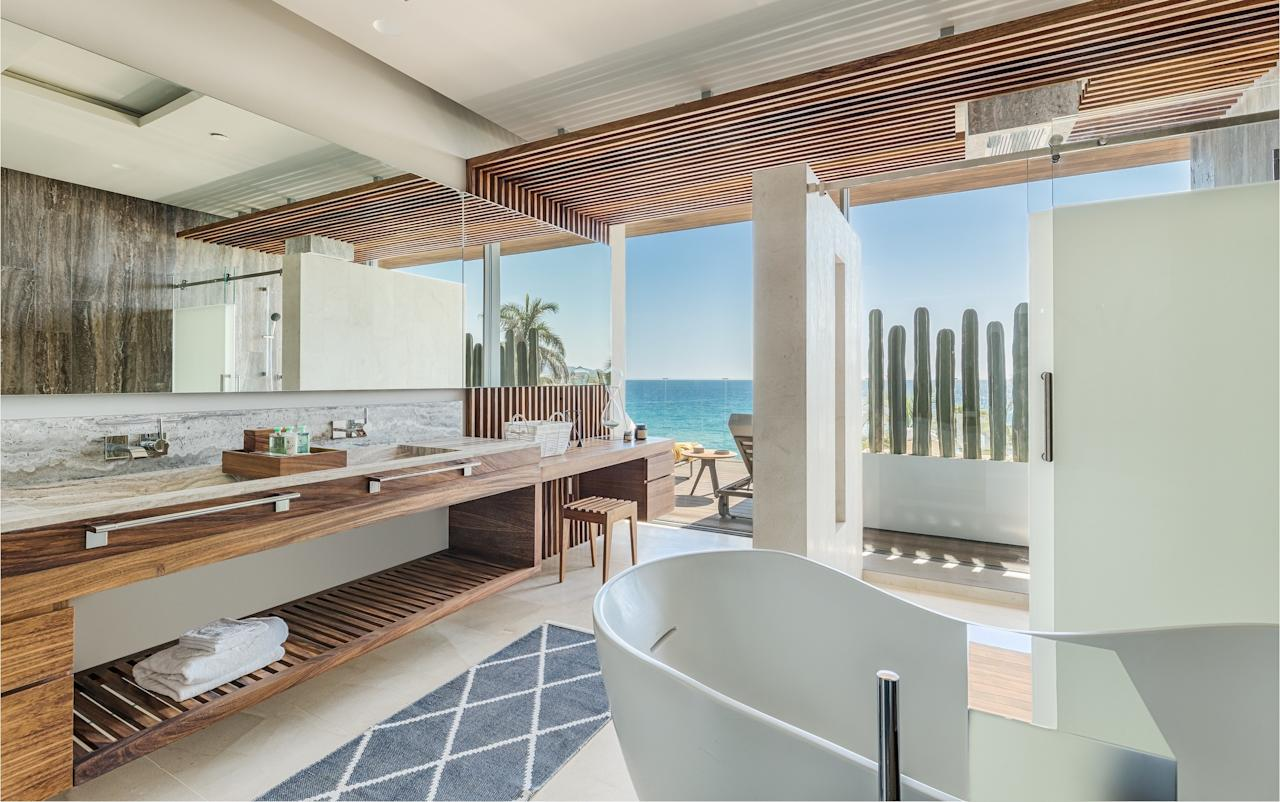 "The Mexican architectural firm Sordo Madaleno conceptualized and designed a bathroom in the resort (which opened in September 2018) to reflect the desert vegetation of Mexico's Baja California Peninsula, the region where it's located. Materials used included quarry stone, granite, marble, and wood—a combination that results in a lavish tub overlooking the Sea of Cortez and offering glimpses of the white-sand beach. <a rel=""nofollow"" href=""https://www.solazloscabos.com/"">solazloscabos.com</a>"