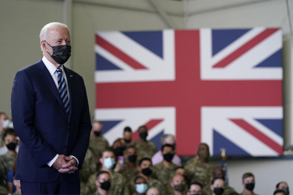 FILE - In this June 9, 2021, file photo, President Joe Biden listens as first lady Jill Biden speaks to American service members at RAF Mildenhall in Suffolk, England. Helping countries recover from the coronavirus pandemic will be at the top of the agenda for the Group of Seven summit when British Prime Minister Boris Johnson welcomes Biden and the leaders of France, Germany, Italy, Japan and Canada to the cliff-ringed Carbis Bay beach resort in southwestern England on Friday, June 11. (AP Photo/Patrick Semansky, File)