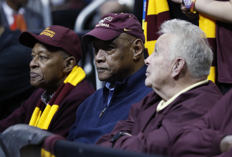 Loyola Chicago's Jerry Harkness, from left, Les Hunter and John Egan were part of the 1963 championship team. (AP Photo/David Goldman, File)