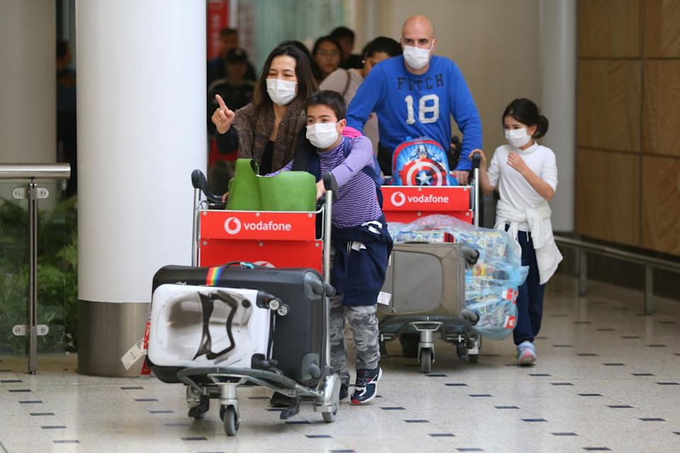 Passengers arrive in Australia from the flight from Wuhan prior to officials temporarily closing down transport from the city. Source: Getty
