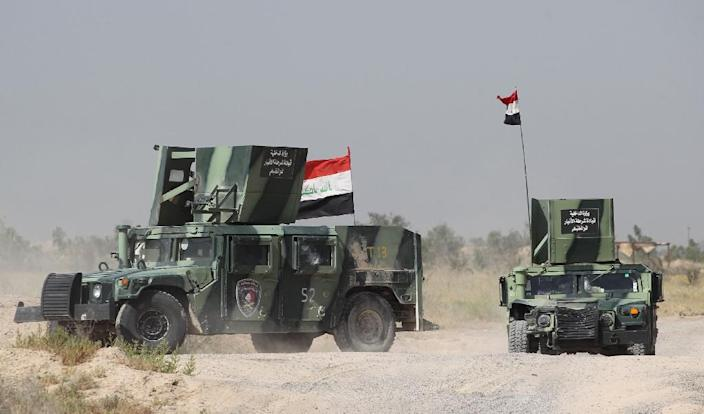 Iraqi government forces deploy in an area on the southern outskirts of Fallujah on June 1, 2016 (AFP Photo/Ahmad al-Rubaye)