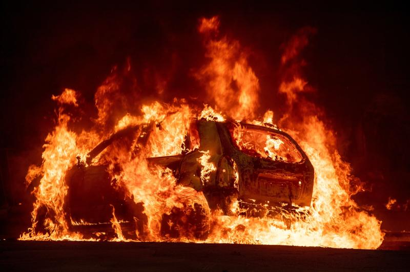 A car explodes into flames as the Camp fire tears through downtown Paradise, California on Nov. 8. (JOSH EDELSON via Getty Images)