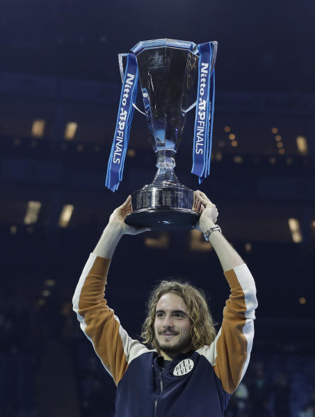 Stefanos Tsitsipas of Greece holds up the trophy and celebrates after defeating Austria's Dominic Thiem in the final of the ATP World Finals tennis match at the O2 arena in London, Sunday, Nov. 17, 2019. (AP Photo/Kirsty Wigglesworth)