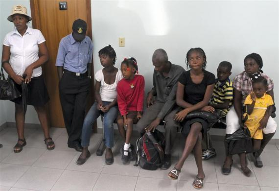 Haitian girl Fabien Destine (3rd L), 14, who suffers from VSP congenital heart disease, or a hole in the chamber wall, waits with other patients inside the Degand Clinic to be examined by an international cardiac mission in Port-au-Prince, April 15, 2012.