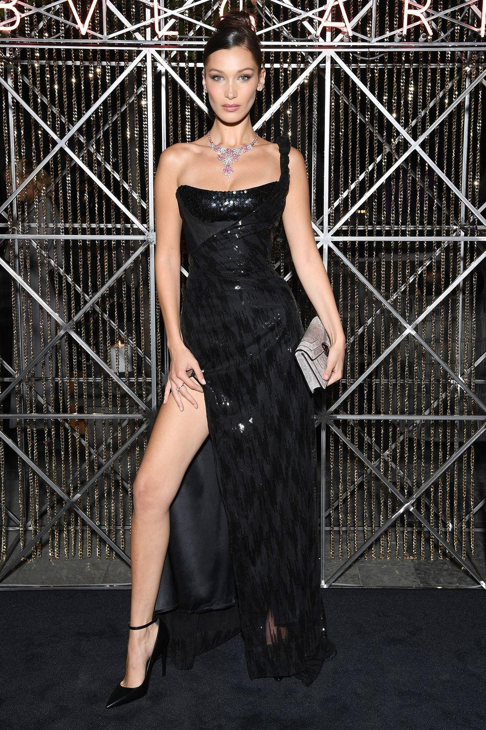 <p>In a Vivienne Westwood couture gown, ankle-strap pumps, and a Bvlgari clutch and accessories at Bvlgari's dinner party in Milan.</p>