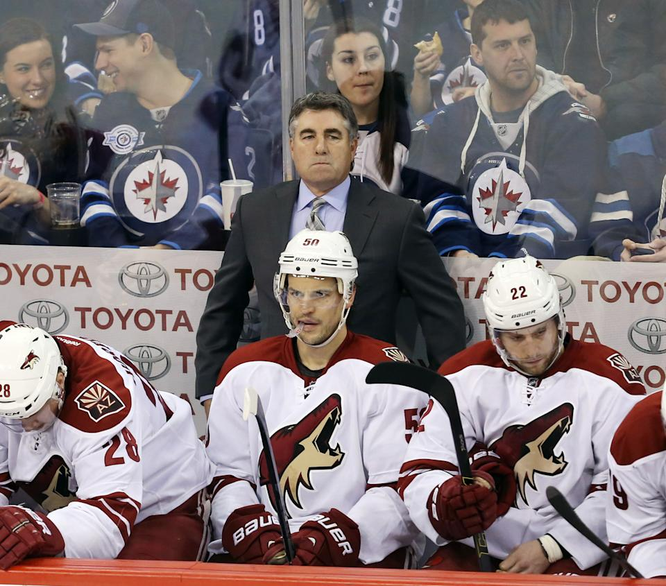 Jan 18, 2015; Winnipeg, Manitoba, CAN; Arizona Coyotes head coach Dave Tippett reacts during the third period against the Winnipeg Jets at MTS Centre. Winnipeg wins 4-3 in overtime. (Bruce Fedyck-USA TODAY Sports)