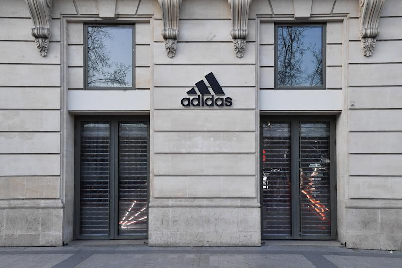 PARIS, FRANCE - MARCH 30: View of closed Adidas store on the Champs Elysees during the Coronavirus epidemic on March 30, 2020 in Paris, France. The country is fining people caught in violation of its national lockdown measures to stop the spread of COVID-19. The pandemic has spread to at least 182 countries, killing more than 37,000 and infecting hundreds of thousands more. (Photo by Stephane Cardinale - Corbis/Corbis via Getty Images)