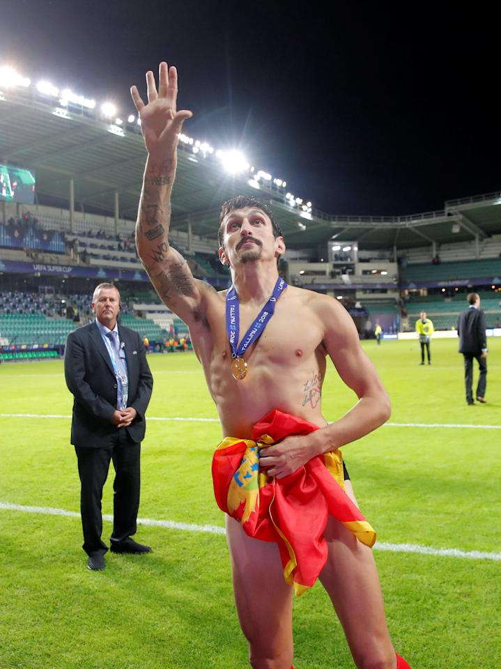 Soccer Football - Super Cup - Real Madrid v Atletico Madrid - Lillekula Stadium, Tallinn, Estonia - August 15, 2018  Atletico Madrid's Stefan Savic celebrates after winning the Super Cup             REUTERS/Maxim Shemetov