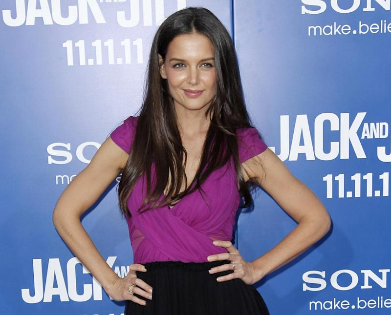 "FILE - This Nov. 11, 2011 file photo shows actress Katie Holmes at the premiere of ""Jack and Jill"" in Los Angeles.  Holmes will star in Theresa Rebeck's new play, ""Dead Accounts,"" a five character comedy, directed by three-time Tony Award winner Jack O'Brien.  The play will open on Broadway this fall at the Music Box Theatre in New York. (AP Photo/Matt Sayles, file)"