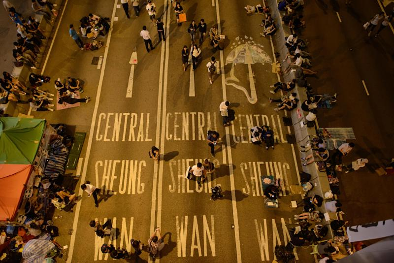 Pro-democracy protesters occupy a road in the Admiralty district of Hong Kong on October 9, 2014 (AFP Photo/Ed Jones)