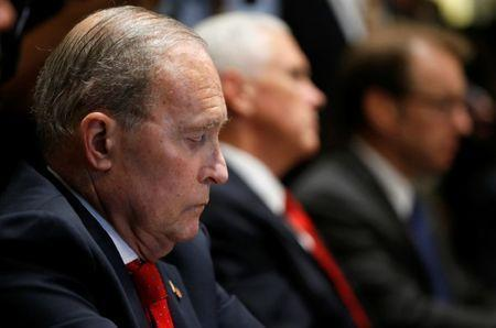 U.S. National Economic Council Director Larry Kudlow listens to U.S. President Donald Trump speak about his summit with Russia's President Vladimir Putin as Kudlow sits beside Vice President Mike Pence during a meeting with members of the U.S. Congress at the White House in Washington, July 17, 2018. REUTERS/Leah Millis
