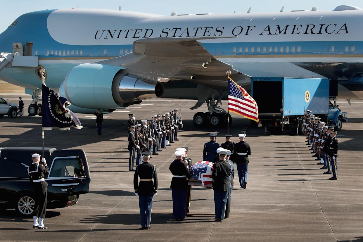 A military honor guard in Houston takes the former president's remains to Special Air Mission 41 to be flown to Washington.