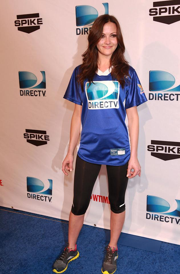 """Entertainment Tonight"" correspondent Christina McClarty arrives at the DirecTV Celebrity Beach Bowl in Indianapolis."