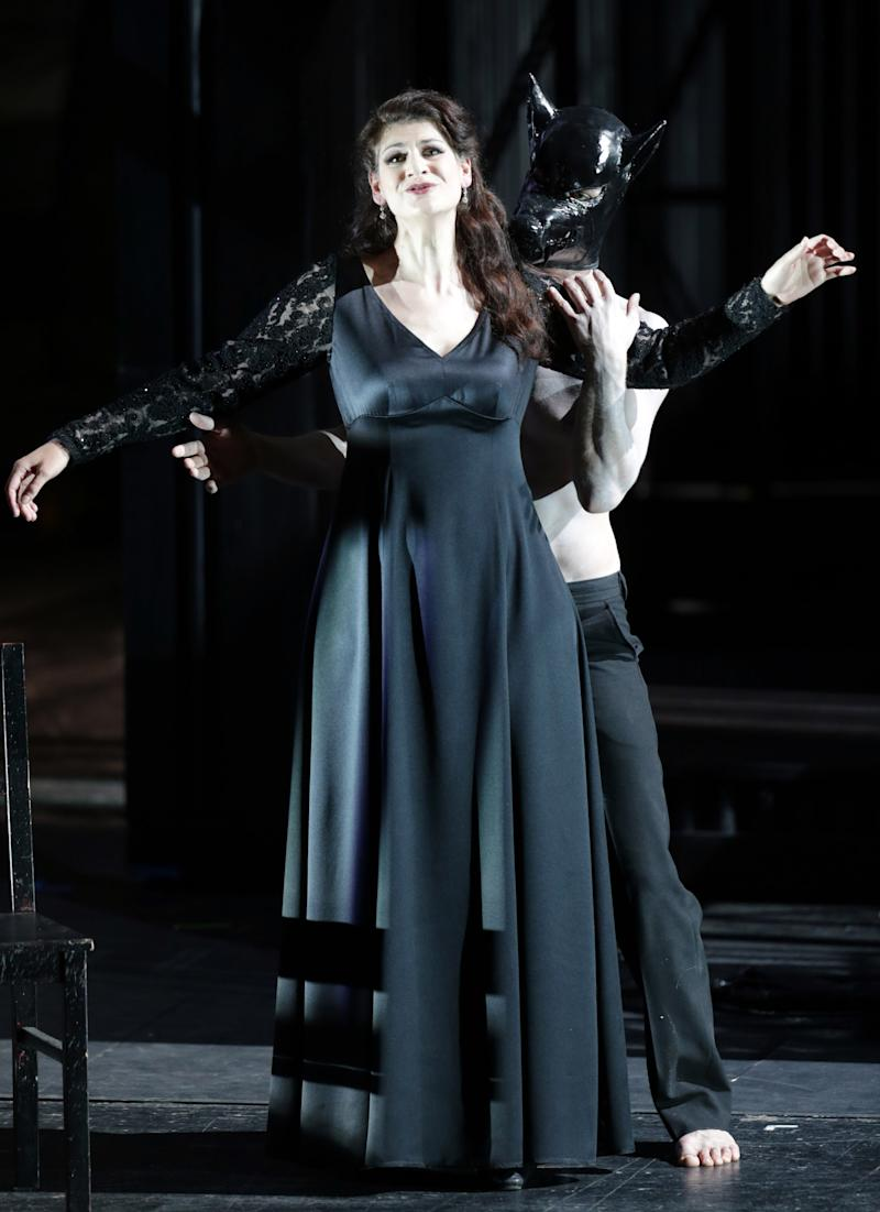 "In this picture taken Friday, June 21, 2013, Anja Harteros in the role of Leonora sings during a dress rehearsal for the opera ""Il Trovatore"" by Giuseppe Verdi in the Bavarian State Opera House in Munich, southern Germany. This wild new production by Olivier Py opened the company's annual Munich Opera Festival. It's a non-stop barrage of nightmarish images mixing styles and periods that assault the audience at lightning speed on a multi-tiered revolving set. (AP Photo/Matthias Schrader)"