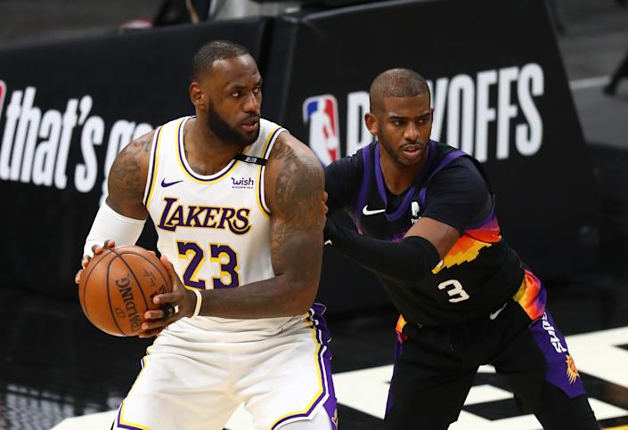 May 23, 2021; Phoenix, Arizona, USA; Los Angeles Lakers forward LeBron James (23) against Phoenix Suns guard Chris Paul (3) during game one in the first round of the 2021 NBA Playoffs. at Phoenix Suns Arena. Mandatory Credit: Mark J. Rebilas-USA TODAY Sports