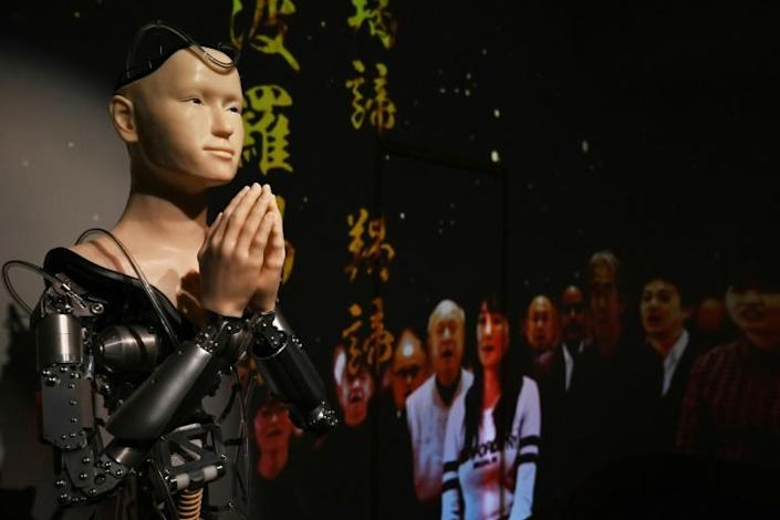 With religion's influence on daily life flat-lining in Japan, proponents hope Kodaiji's robot priest will be able to reach younger generations in a way traditional monks can't (AFP Photo/CHARLY TRIBALLEAU)