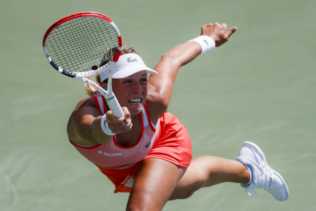 Anett Kontaveit, of Estonia, returns to Ashleigh Barty, of Australia, during the quarterfinals of the Western & Southern Open tennis tournament, Thursday, Aug. 15, 2019, in Mason, Ohio. (AP Photo/John Minchillo)