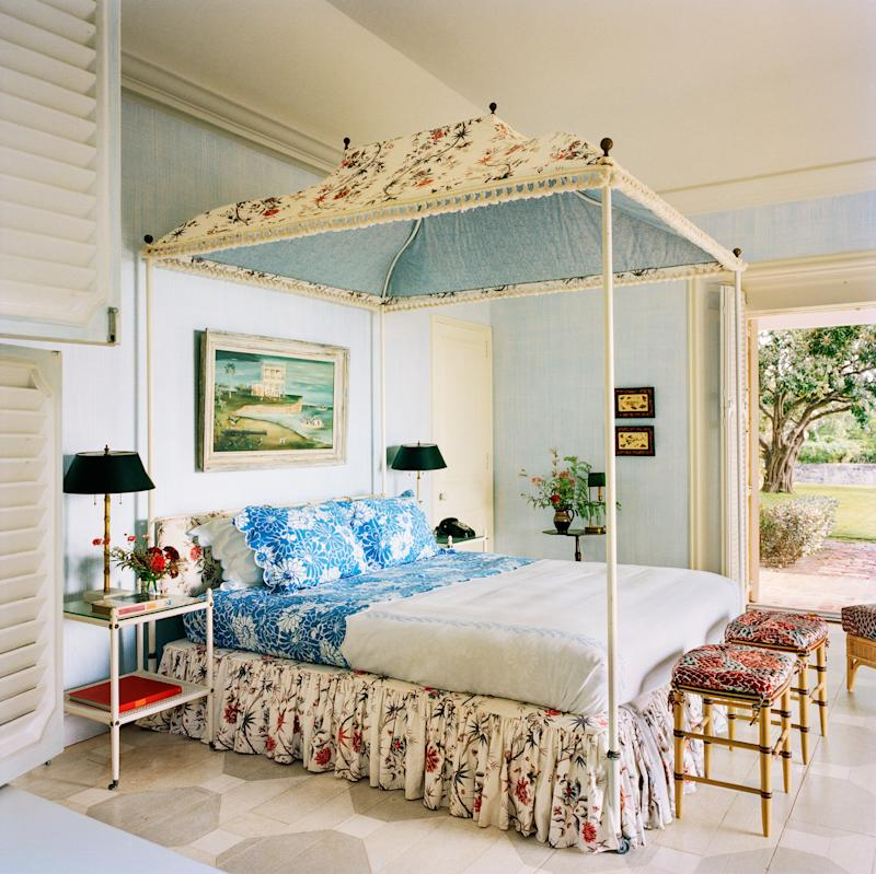 Burch's bedroom, with linens by D. Porthault and a bed canopy in cottons by Pierre Frey and Le Manach.