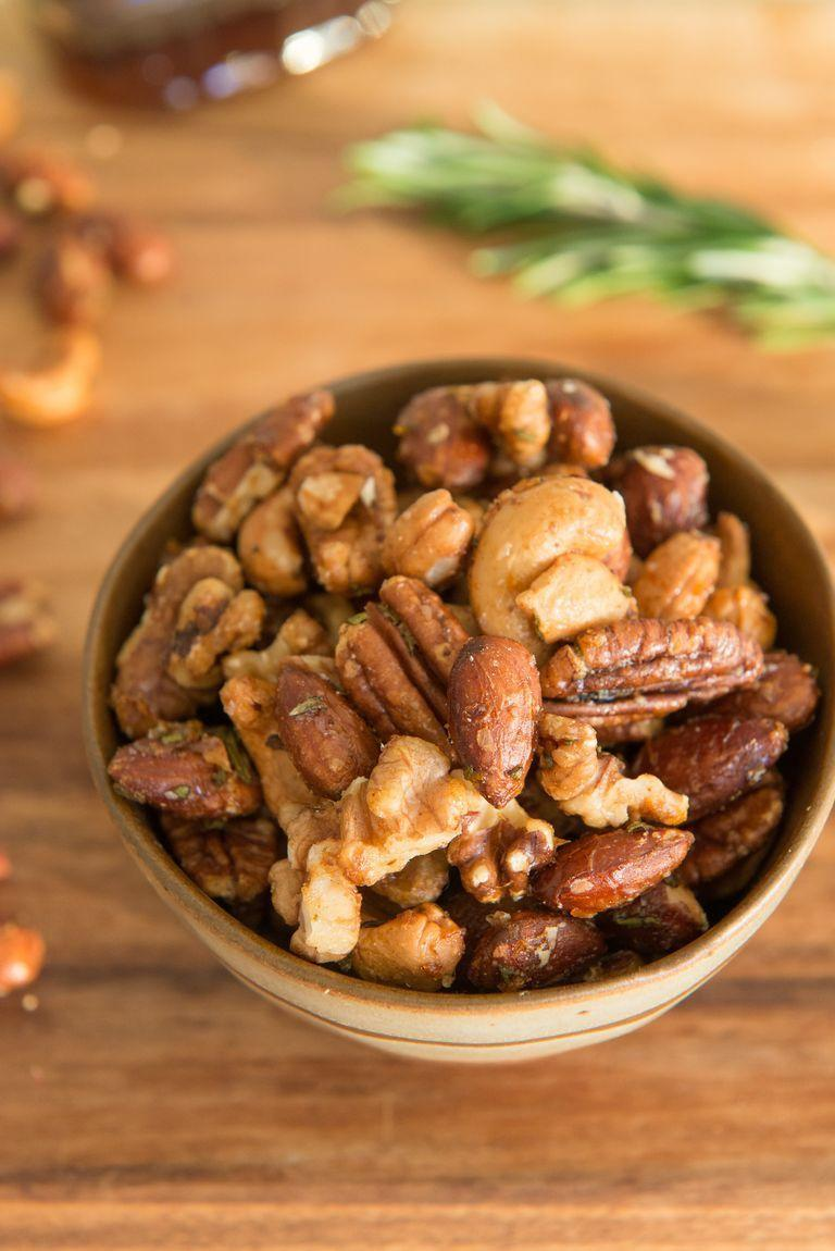 """<p>Jazz up cocktail nuts with this recipe. They're infused with rosemary, maple syrup, and orange zest for a seasonal bite.</p><p><strong><a href=""""https://www.thepioneerwoman.com/food-cooking/recipes/a90390/fancy-roasted-cocktail-nuts/"""" rel=""""nofollow noopener"""" target=""""_blank"""" data-ylk=""""slk:Get the recipe."""" class=""""link rapid-noclick-resp"""">Get the recipe.</a></strong></p><p><strong><a class=""""link rapid-noclick-resp"""" href=""""https://go.redirectingat.com?id=74968X1596630&url=https%3A%2F%2Fwww.walmart.com%2Fsearch%2F%3Fquery%3Dpioneer%2Bwoman%2Bsnack%2Bbowls&sref=https%3A%2F%2Fwww.thepioneerwoman.com%2Ffood-cooking%2Fmeals-menus%2Fg34272733%2Fchristmas-party-appetizers%2F"""" rel=""""nofollow noopener"""" target=""""_blank"""" data-ylk=""""slk:SHOP BOWLS"""">SHOP BOWLS</a><br></strong></p>"""