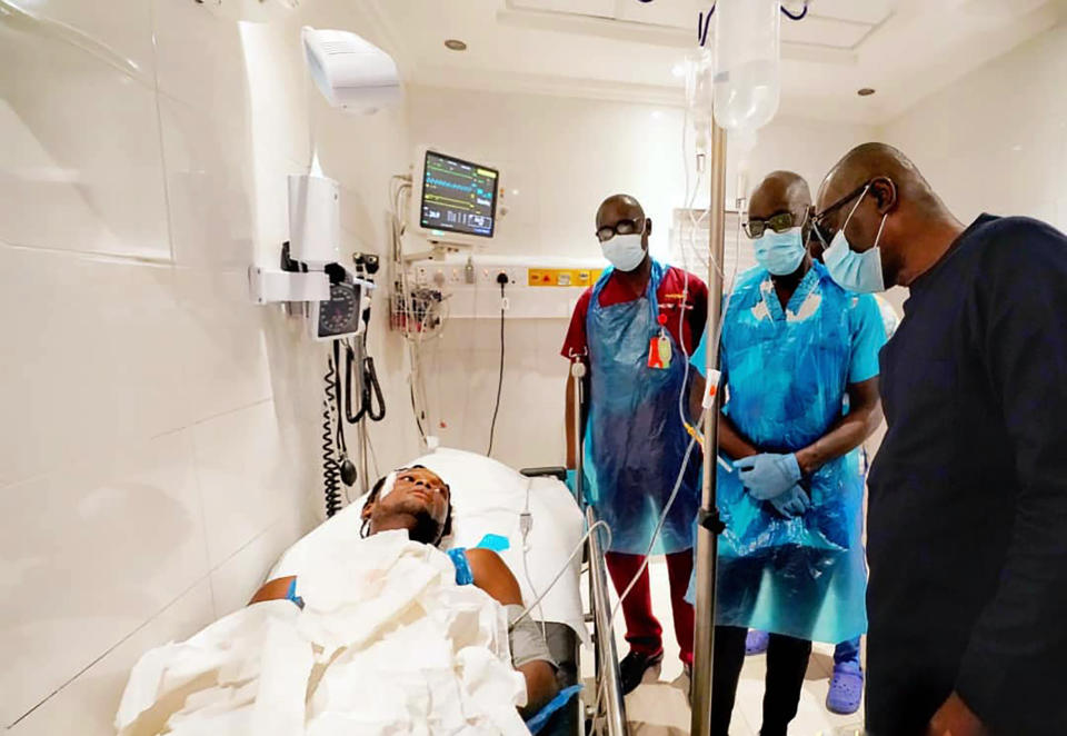 In this photo released by the Lagos State government press, governor Babajide Sanwo-Olu, right, visit victims injured in last night's protests in a hospital in Lagos, Nigeria, Wednesday Oct. 21, 2020. Nigerians protesting against police brutality stayed on the streets in Lagos on Wednesday, breaking the government curfew following a night of chaotic violence in which demonstrators were fired upon, sparking global outrage. (Lagos State government press Via AP)