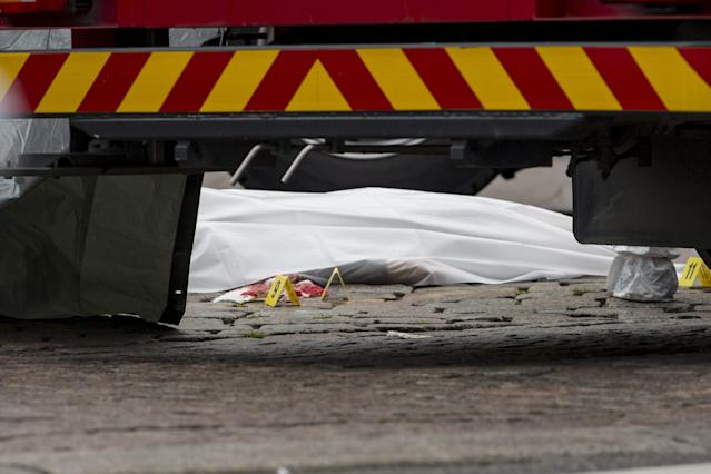 <p>Rescue personnel have covered a stabbing victim's body at the Turku Market Square in the Finnish city of Turku where several people were stabbed on Aug. 18, 2017. (Roni Lehti/AFP/Getty Images) </p>