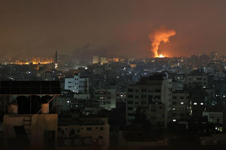 An explosion lights the sky following an Israeli airstrike on Beit Lahia in the northern Gaza Strip. / Credit: MOHAMMED ABED/AFP via Getty