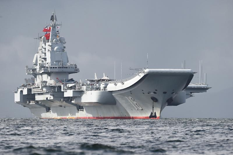 China's sole aircraft carrier has conducted a string of drills recently in waters where Beijing has disputes with its neighbours (AFP Photo/Anthony WALLACE)