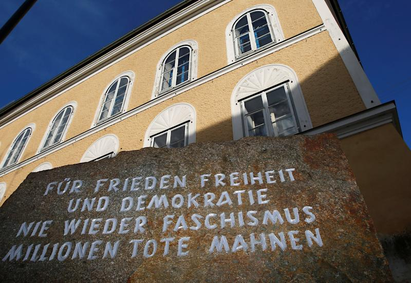 A stone outside the house in which Adolf Hitler was born, with the inscription 'For peace, freedom and democracy, never again fascism, millions of dead are a warning', is pictured in the northern Austrian city of Braunau am Inn September 24, 2012. A suggestion to turn the Austrian house where Adolf Hitler was born into normal residential space has triggered a debate about how best to use an empty property still laden with historic baggage decades after World War Two ended. The man who became Nazi dictator was born in the house in Braunau on the Inn, a town near Salzburg on the German border, in April 1889. His family lived there only three years, but his link to the three-storey building has left an indelible mark. REUTERS/Dominic Ebenbichler/File Photo