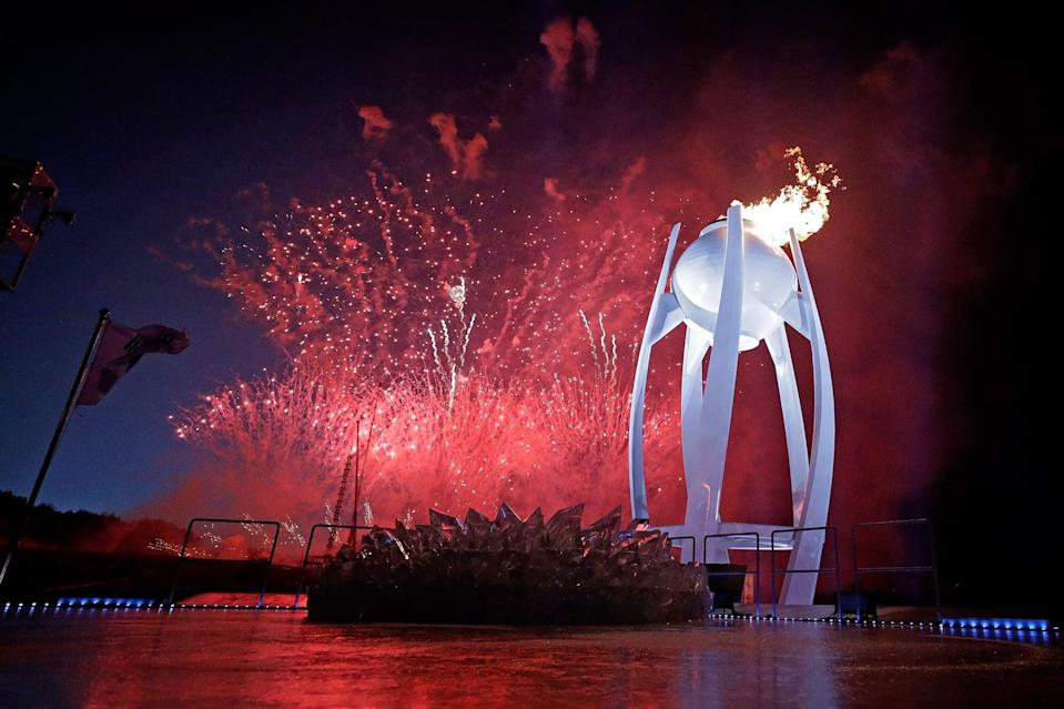 PYEONGCHANG-GUN, SOUTH KOREA - FEBRUARY 09:  Fireworks erupt as the Olympic Cauldron is lit during the Opening Ceremony of the PyeongChang 2018 Winter Olympic Games at PyeongChang Olympic Stadium on February 9, 2018 in Pyeongchang-gun, South Korea.  (Photo by Pool - David J. Phillip/Getty Images)